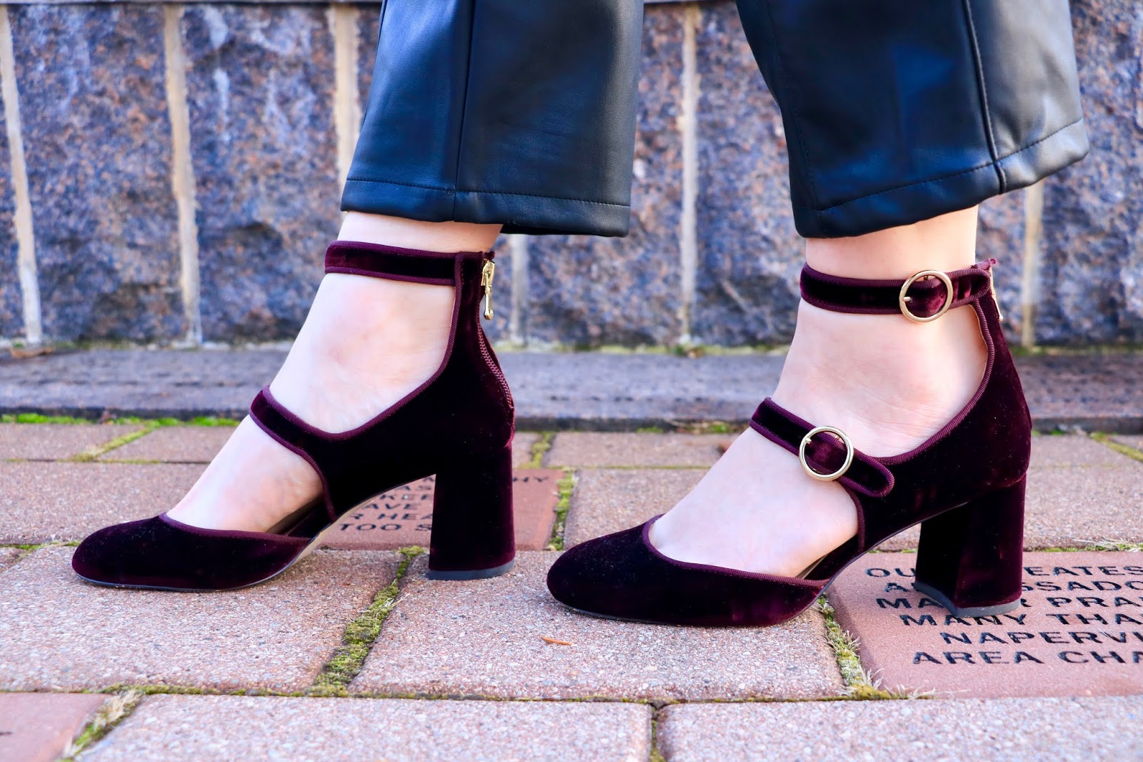 Nyc fashion blogger Kathleen Harper wearing burgundy velvet ankle strap heels.