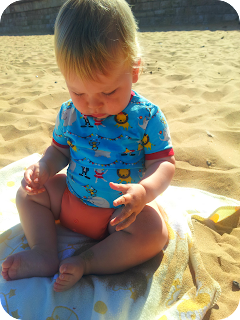baby discovering sand