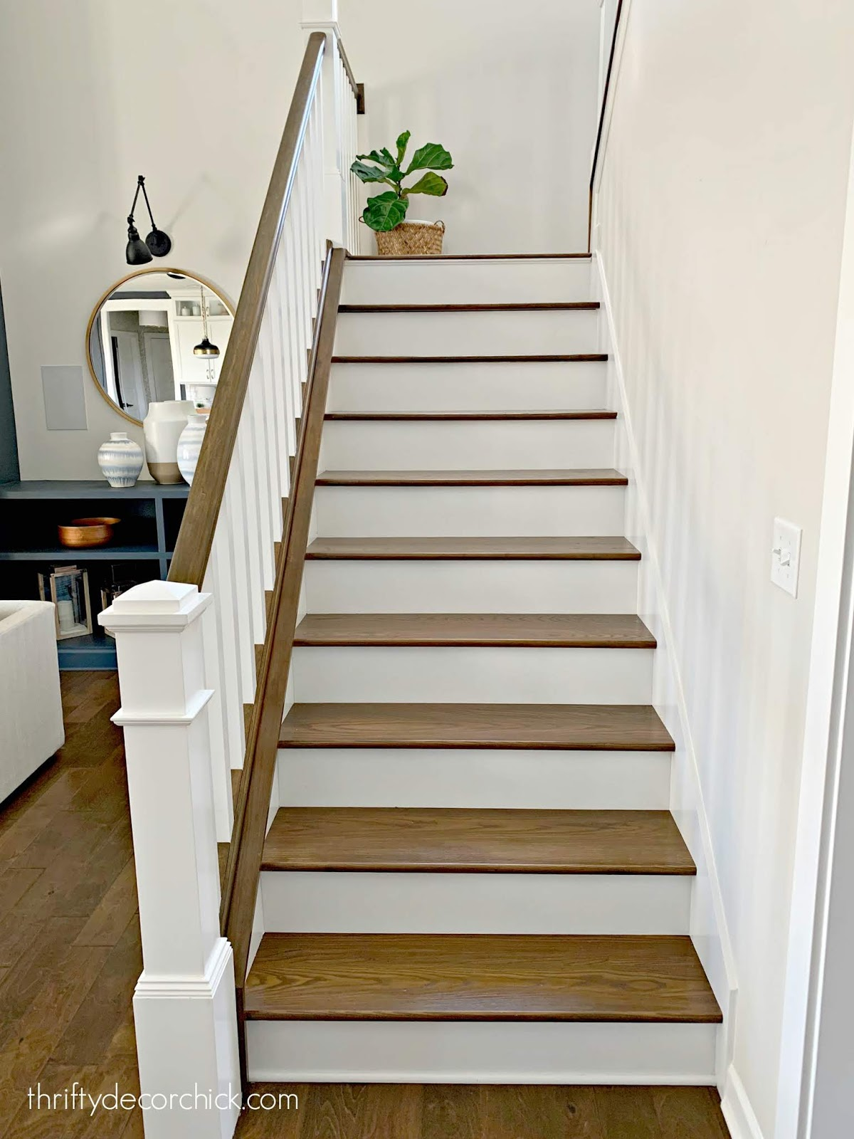 Stairs with stained treads and hand rails, white risers and balusters