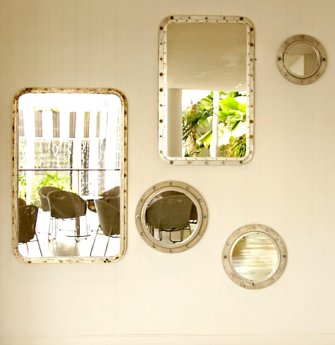 nautical gallery wall with porthole mirrors