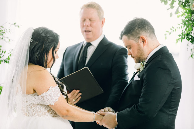 bride and groom praying during ceremony