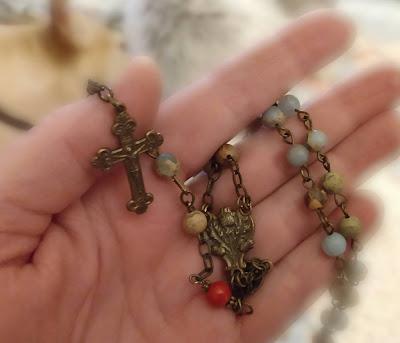 dainty rosary in my hand