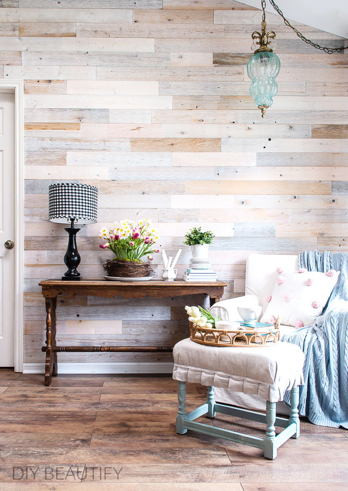 wood wall, Spring decorated console table and neutral furnishings