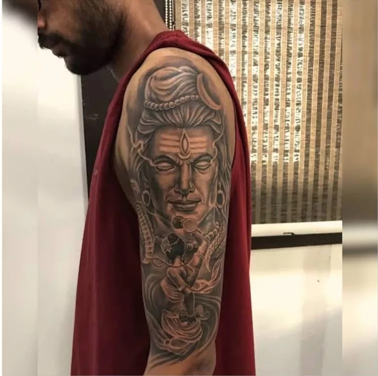 Shiva tattoo on shoulder