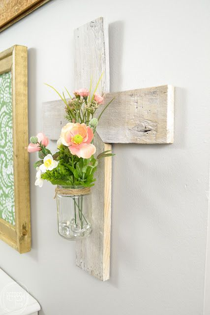 Rustic whitewashed wooden cross made from scrap wood.