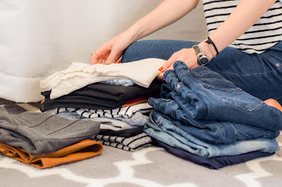 woman folding clothes for home move