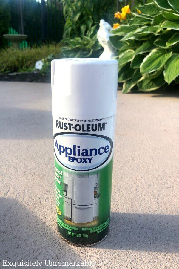 Rust-Oleum spray paint can on garden patio