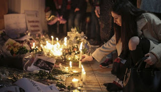 Moroccans hold anti-terror vigil for Scandinavian university students killed.