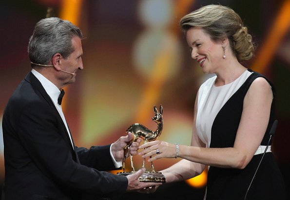 Queen Mathilde wore a two-tone crepe gown by Carolina Herrera. Bambi Awards at Festspielhaus. crystals and structure clutch