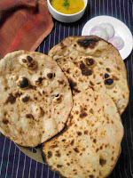 Serving 3 pieces of tandoori roti with dal and onion slices