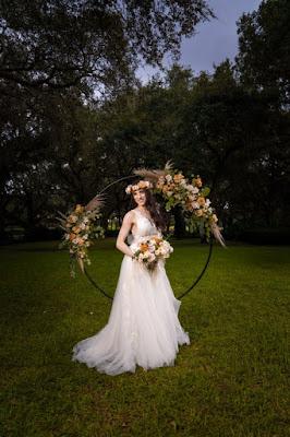 bride at ceremony arch