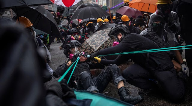 China says 'political virus' of violent protests must be removed in Hong Kong