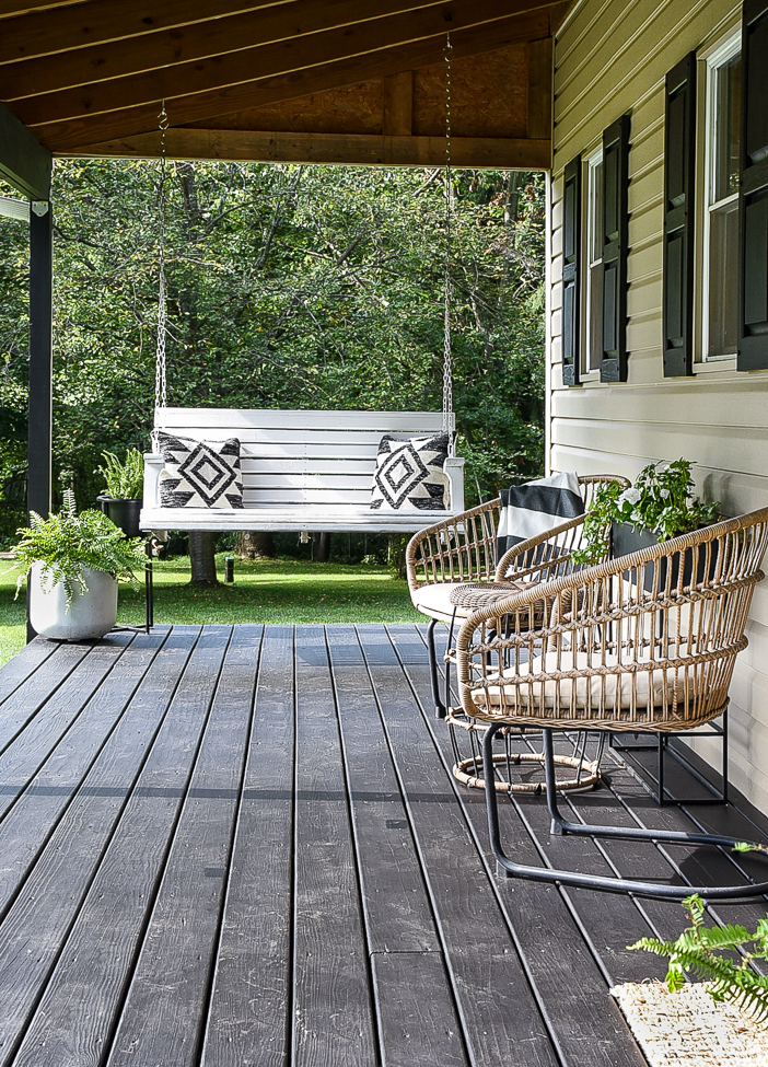 white painted deck swing and modern decor