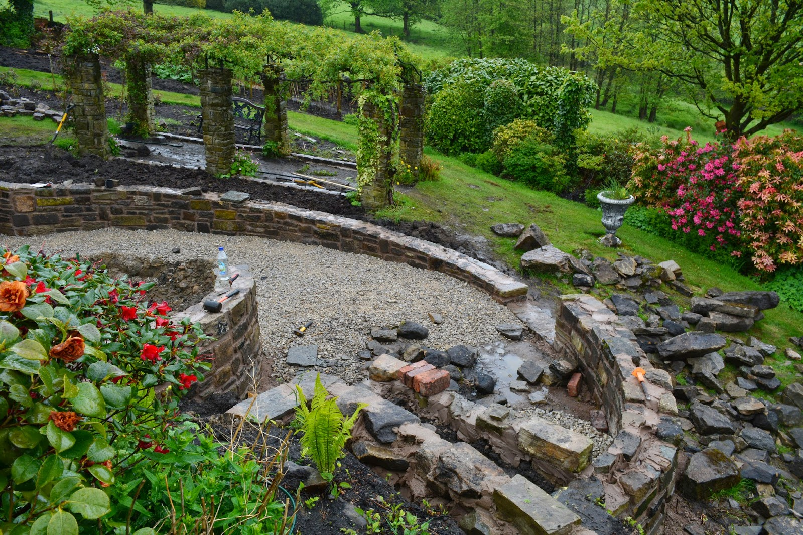 The Weather Has Changed Bringing Rain But Work Continues With Walls To Lower Pond Areas Now Taking Shape And Timber Frame Accommodate Inset Seats