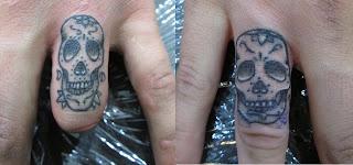 sugar skull finger tattoos