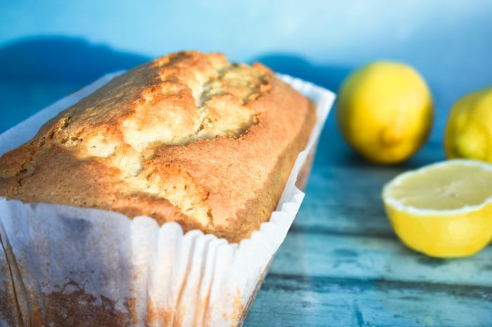 Lemon cake in a loaf tin liner before it is iced