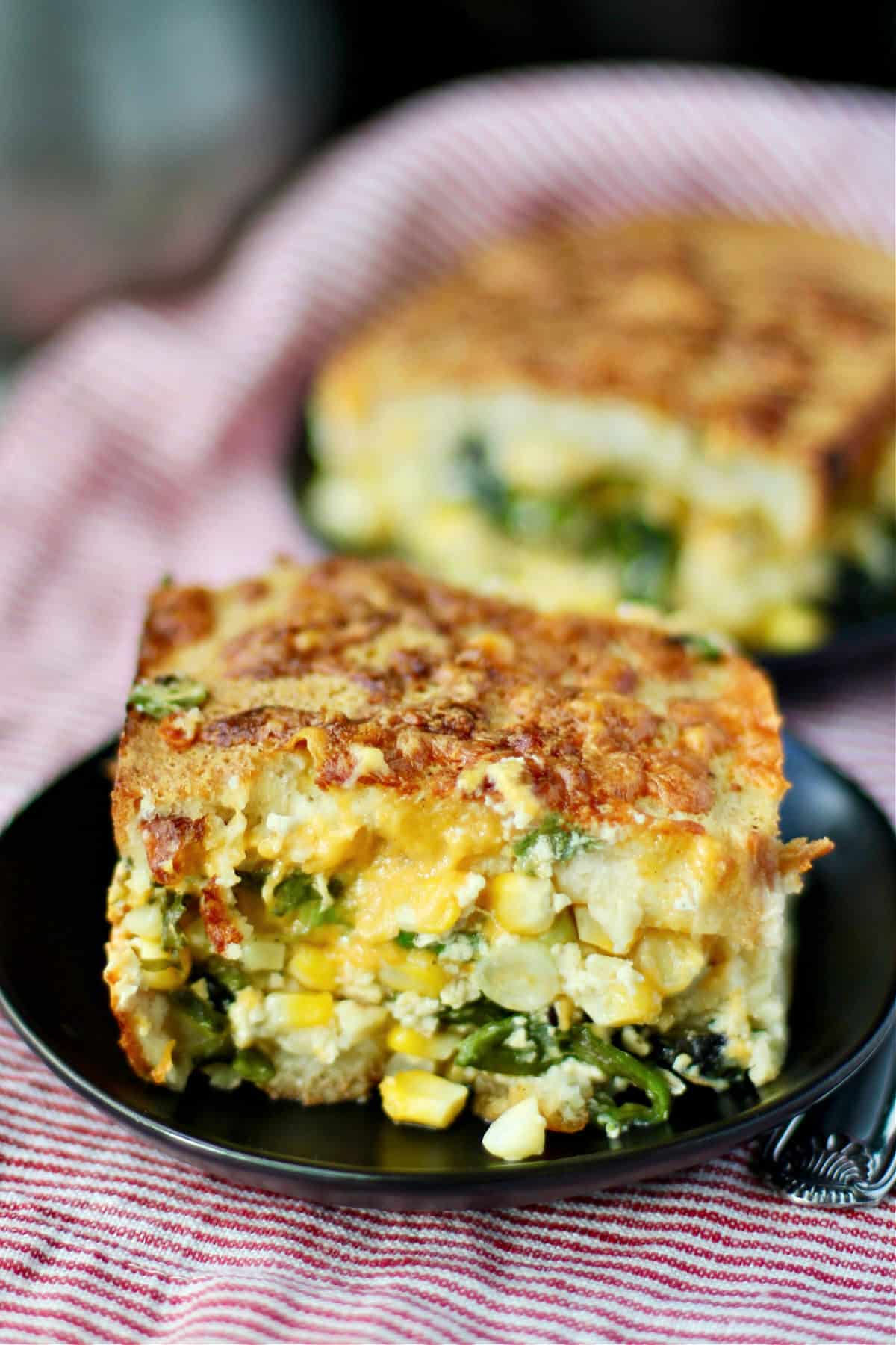 Breakfast strata with sweet corn on a plate.