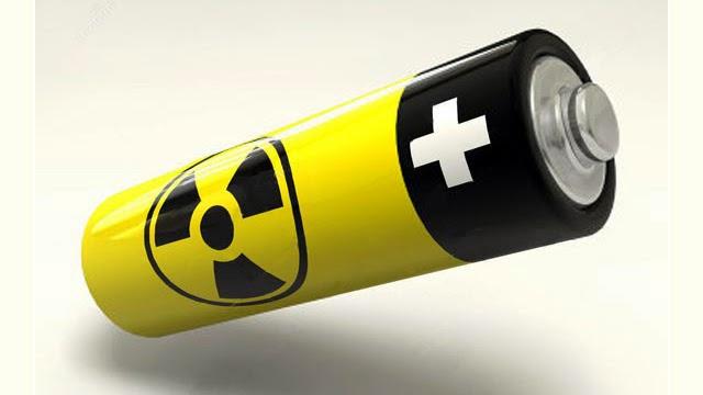 """صورة لبطارية صغيرة من طراز """" AA Baterry """" وعليها صورة شعار نووي"""