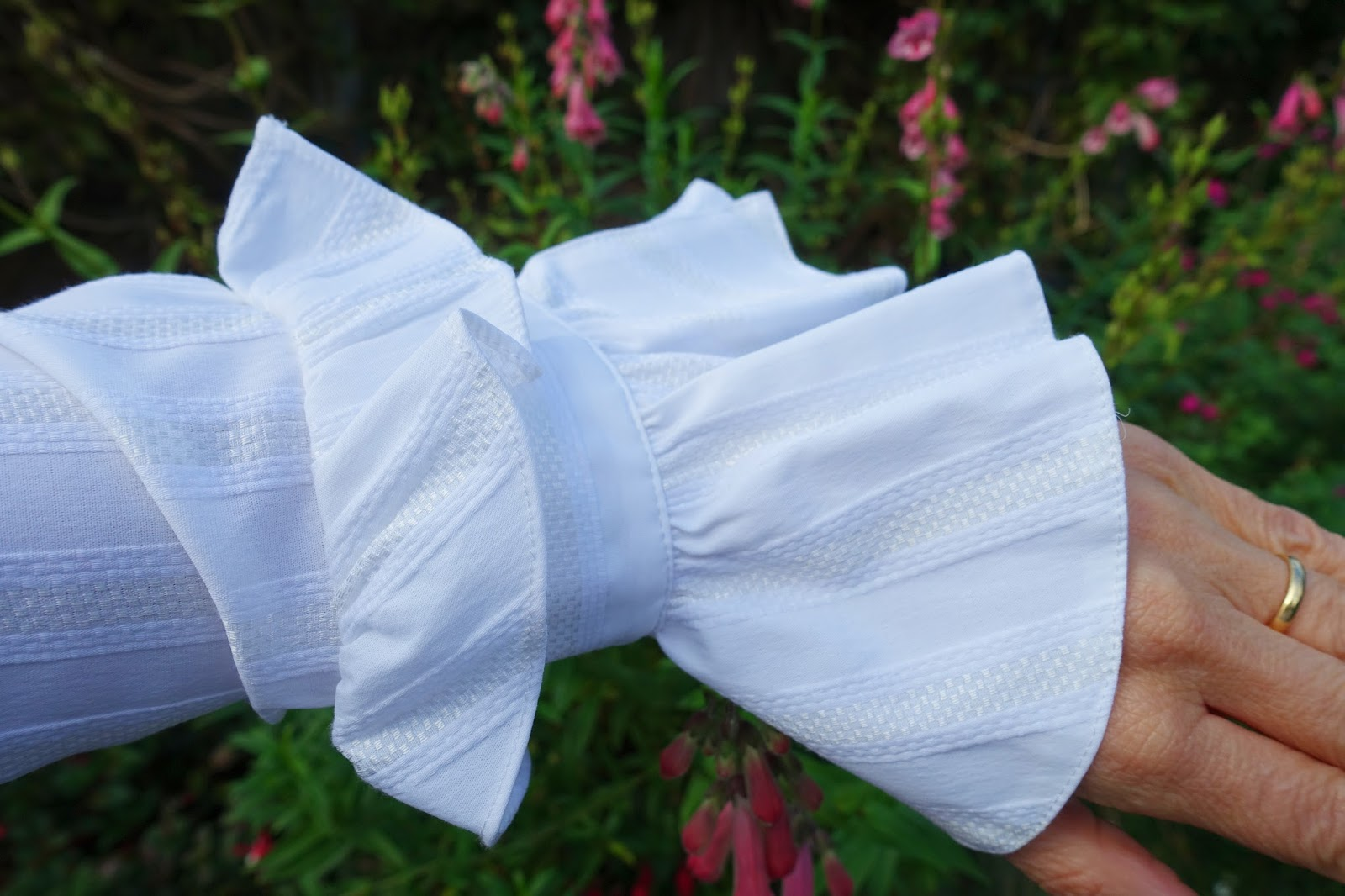 Image showing a close up of the frilled sleeve shirt by Teatum Jones from Mix at Next