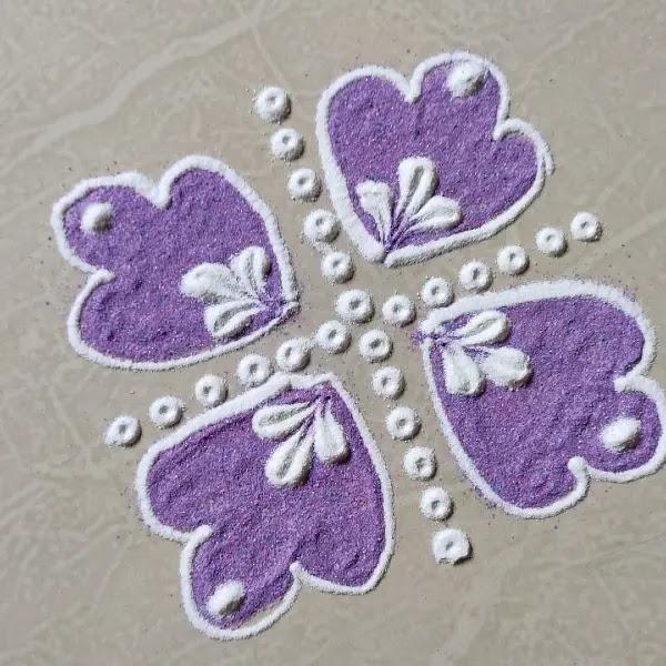 Purple_white_colour_rangoli_design