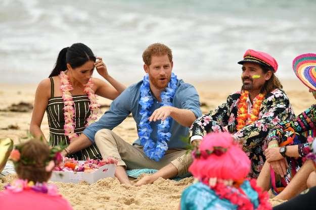 Photos: Royals Harry and Meghan go barefoot on Bondi