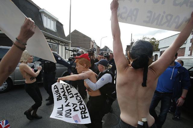 ΙΣΤΟΡΙΕΣ ΓΙΑ ΓΕΛΙΑ ! ! ΟΙ γραφικες Femen: «χτύπησαν» με γυμνόστηθη διαμαρτυρία στο εκλογικό κέντρο που ψήφισε η Λεπέν! (ΦΩΤΟ