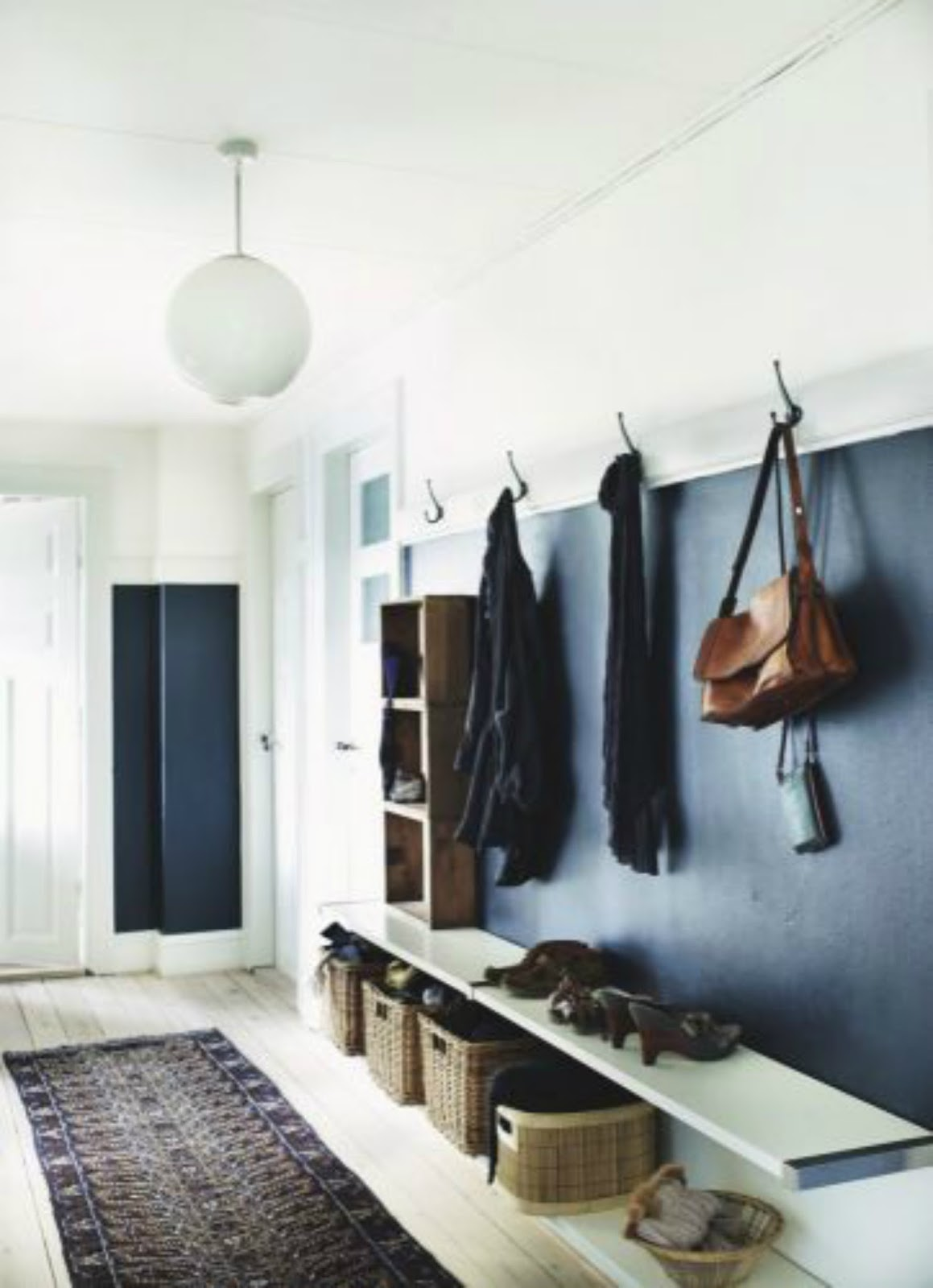 scandinavian mid-century mcm black mudroom entry interior design