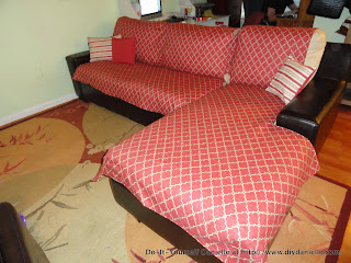 L shaped couch with a custom made cover.