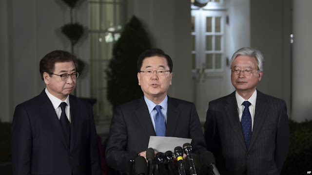 Image Attribute: South Korean national security director Chung Eui-yong, center, speaks to reporters at the White House in Washington, March 8, 2018, as Intelligence Chief Suh Hoon, left and Cho Yoon-je, South Korea's Ambassador to the United States listen. / Source: AP