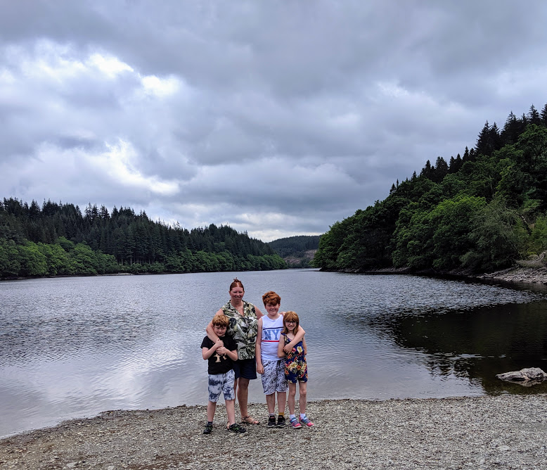 The Three Lochs Forest Drive - A Good Spot for Wild Camping with Kids  - photo beside loch
