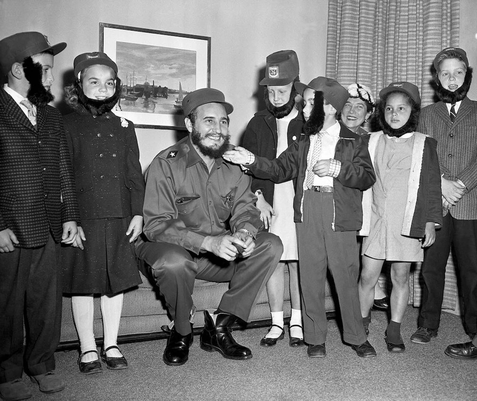 Youngsters admire Fidel Castro's beard during a visit to his hotel. The children attended a Queens school with Castro's son. The boy was secretly living In New York while his father led the Cuban revolution. Left to right: Gene Wolf, Kathy Johnston, Kathy Tableman, David Friedlander, Karen Leland and Robert Boyle.