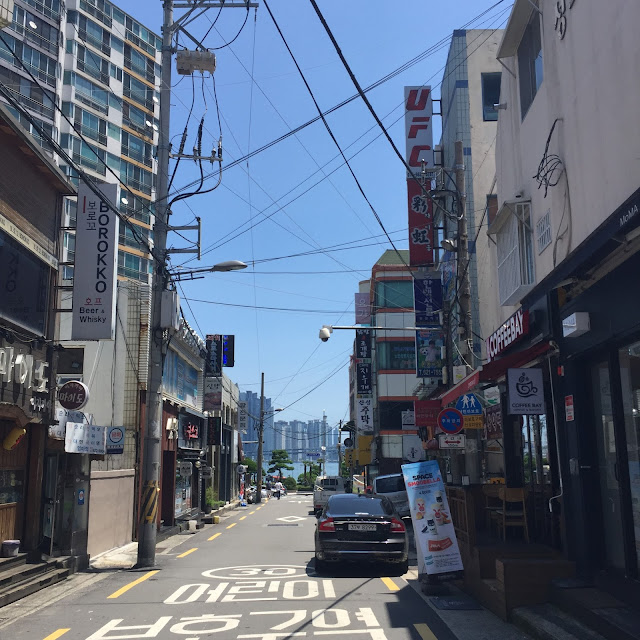 A street leading down to Gwangalli Beach in Busan, South Korea.