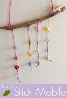 Making a simple stick mobile with buttons and pom poms