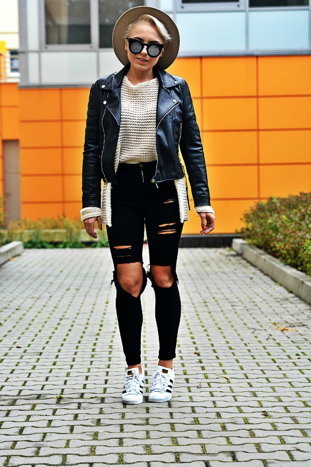 karyn_black_biker_jacket_beige_sweater