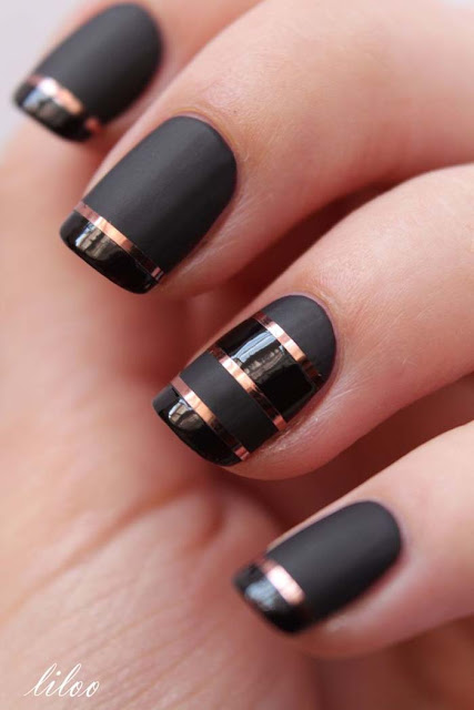Elegant Black and Golden Nail Design.