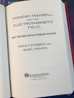 Faraday, Maxwell, and the Electromagnetic Field, by Nancy Forbes and Basil Mahon, superimposed on Intermediate Physics for Medicine and Biology.