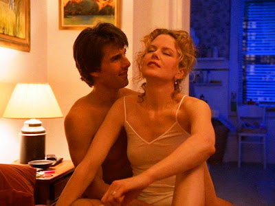 Nicole Kidman as Alice Harford and Tom Cruise as Dr. William 'Bill' Harford in Eyes Wide Shut, getting stoned, erotic reel life scene between real life couple, Directed by Stanley Kubrick
