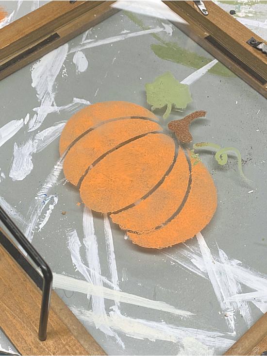 Stenciled pumpkin on glass