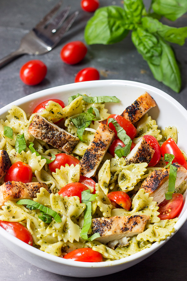 Pesto Pasta with Grilled Chicken - This Pesto Pasta Salad with Grilled Chicken is an easy and delicious weeknight meal. Serve it cold as a summer pasta salad or hot as a delicious winter entree!