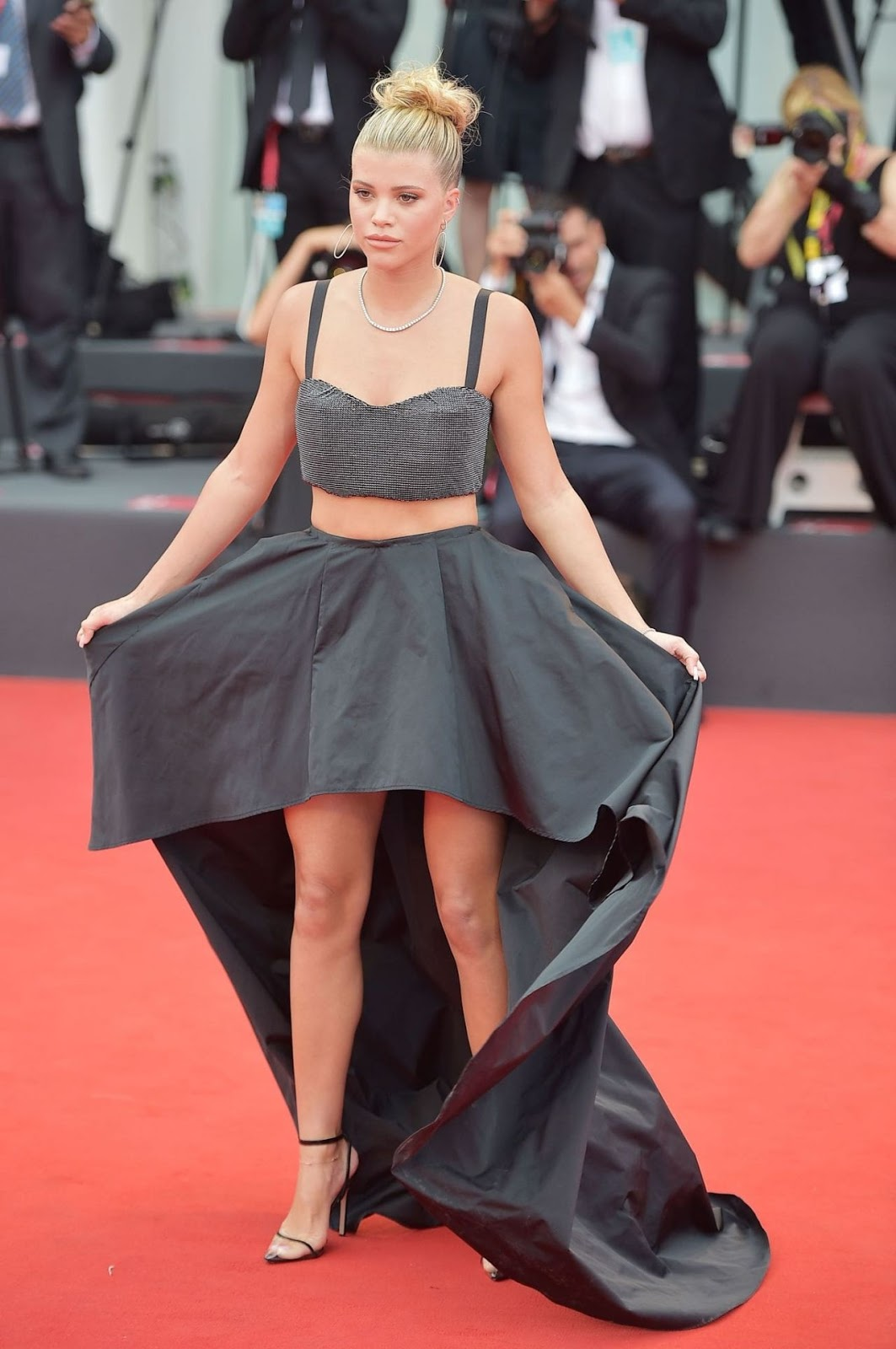 Sofia Richie parades her toned abs in a black sequinned bralet as she leads the star-studded arrivals for the Venice Film Festival opening gala