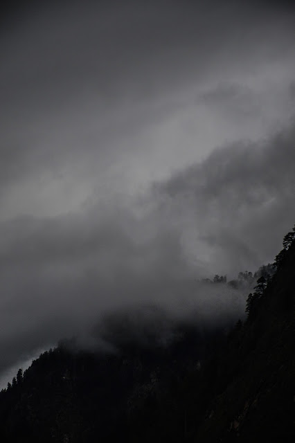 clouds over the mountains at dawn in kasol himachal