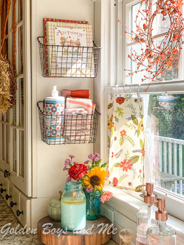 Wall baskets in kitchen for storage - www.goldenboysandme.com
