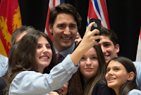 Prime Minister Justin Trudeau with high school students in Ottawa after an information session on climate change. (Credit: Adrian Wyld/The Canadian Press, via Associated Press) Click to Enlarge.