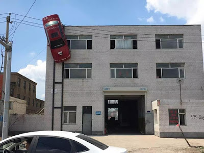 Unbelievable! Man Suspends Car On Outer Wall Of A Building. See Incredible Photos