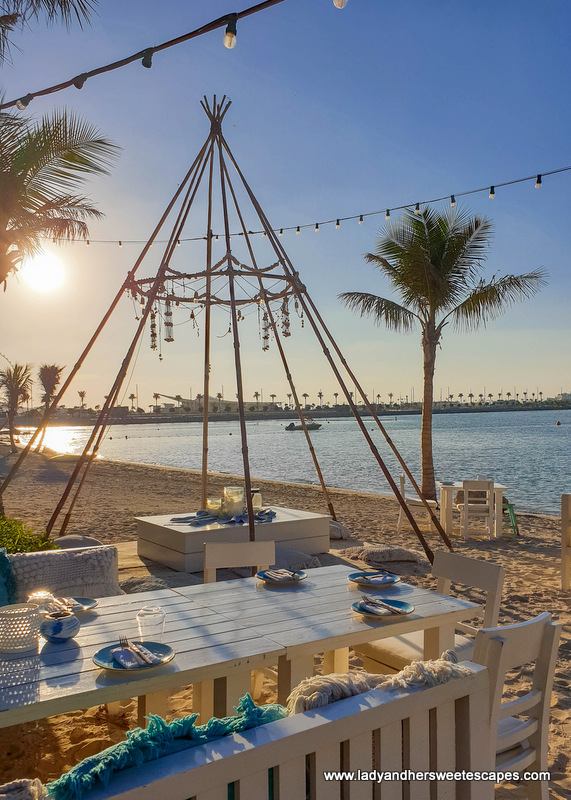 tables by the beach in  Fish restaurant in Dubai
