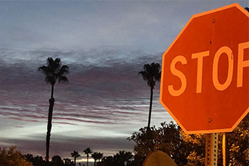 Using a portable stop sign, or the one that is usually there, to block out the streetlamp (Source: Palmia Observatory)