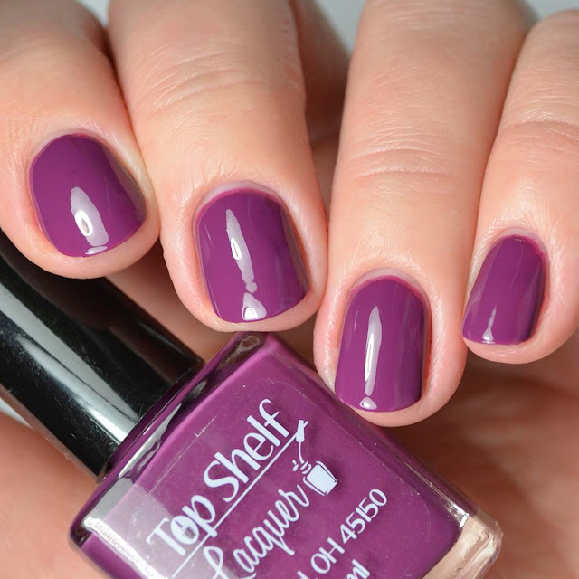 purple nail polish four finger swatch