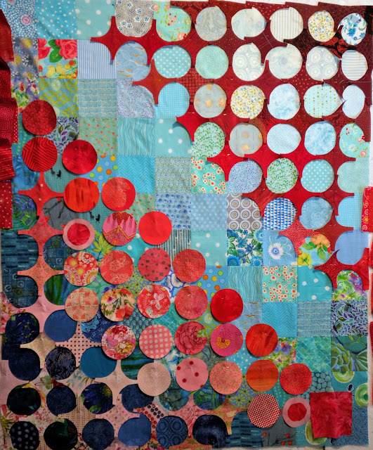 Pink and red fabric hugs and kisses on Circular Anomaly quilts. Double Vision quilts.