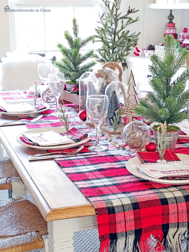 plaid tablecloth and Christmas trees on the table