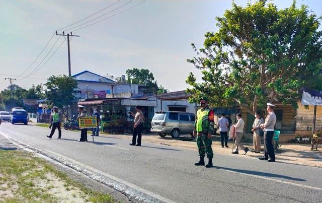 Personel Jajaran Kodim 0207/Simalungun Kompak Dengan Dinas Terkait Laksanakan Razia Masker Diwilayah